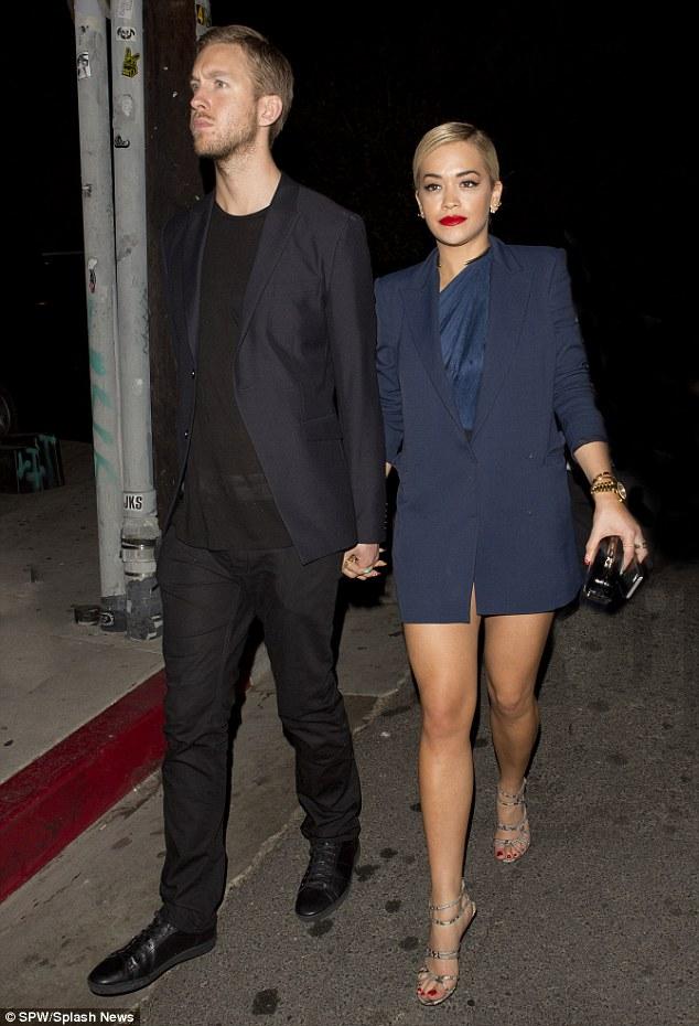 Rita Ora and her boyfriend, DJ Calvin Harris were seen leaving '1 Oak' Night Club in West Hollywood, CA. Rita was wearing just a blue suit jacket as she left the club