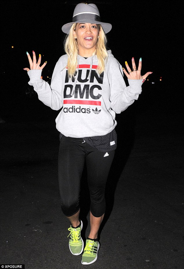 She's nailed it: Rita Ora shows off her garish nails after getting a manicure in West Hollywood on Monday