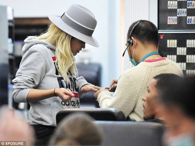 Here we go: The songstress brushed off her reported Rihanna snub by paying a visit to local salon CT Nails