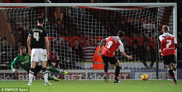 From the spot: Doncaster's Chris Brown (centre) put his side 2-0 up with a 36th-minute penalty