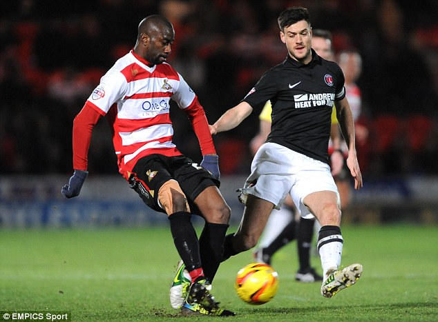 Midfield battle: Charlton's Johnnie Jackson (right) vies for possession with Doncaster's Abdoulaye Meite