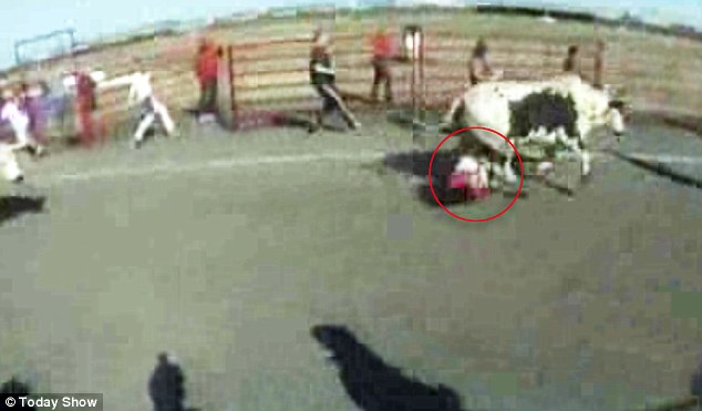 Ouch! Two come along at once: After being pounded by the first bull, Hugo Sotto was in for a direct hit from a second
