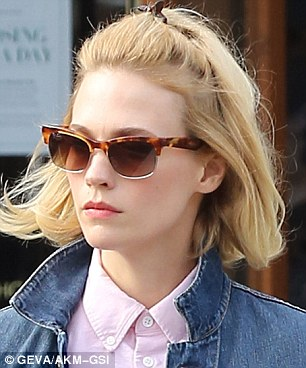 Closeup of a retro look: The beauty wore Ray-Bans, popular during the age of the Brat Pack
