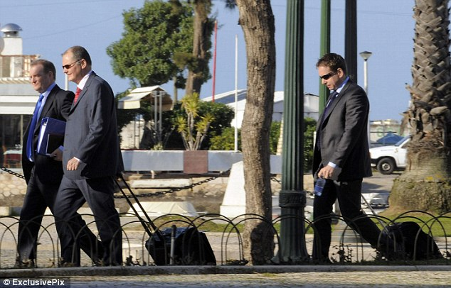 Wearing sunglasses and carrying suitcases full of documents, the officers arrived in Portugal on Monday
