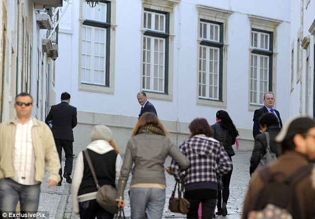 Foreign trip: The investigators were seen in a crowded street in the city of Faro, where they met local police