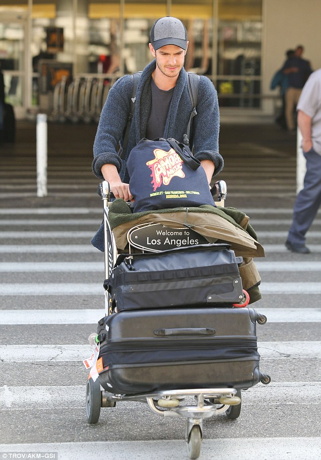 Extra baggage: Staying true to his down to earth persona, Andrew ported his own luggage through the airport - even though he certainly had his fair share of bags