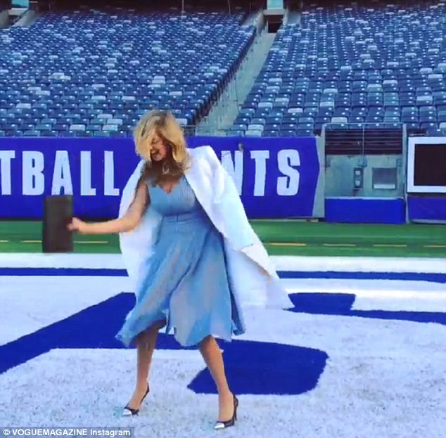 Is there a Kate under there? The Sports Illustrated model got lost beneath her hair in a gust of wind