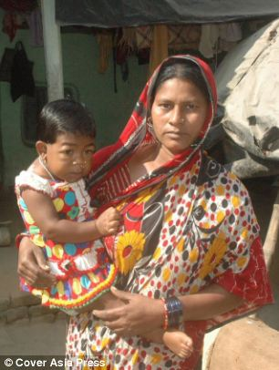 Trapped: Akifa Khatun, 19, stopped growing just before her second birthday and must be carried everywhere by her mother Apila, 42