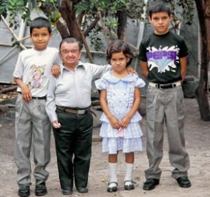 An Ecuadorian man with Laron Syndrome (pictured with his children in the early 1990s)