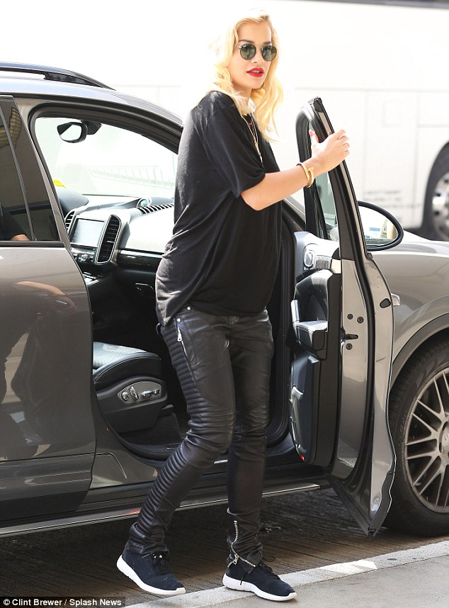 Hello, Hi, Goodbye: The singer opted for an all-black ensemble as she stepped out her car in a pair of monochrome trainers