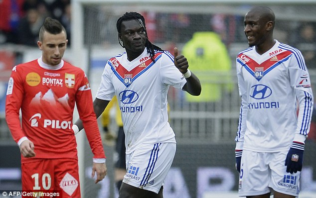 Wishlist: Everton could launch a move for Lyon striker Bafetimbi Gomis (centre) before the window closes