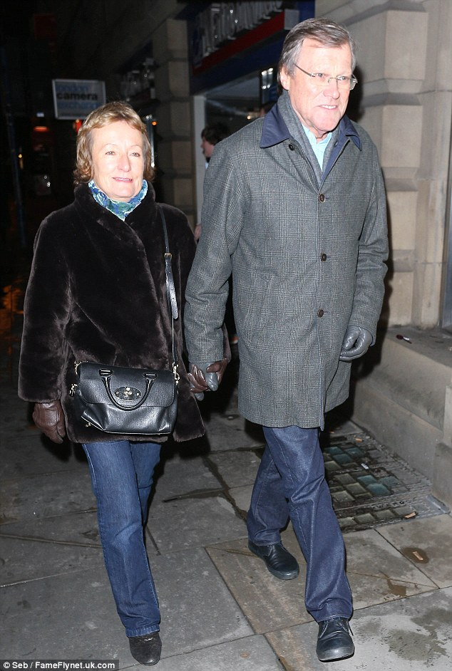 Stepping out: David and wife Jane braved the cold for a night out at the theatre in Manchester