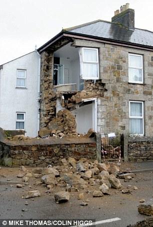 The house in Camborne, Cornwall, whose gable end collapsed down an old a mine shaft pictured this morning