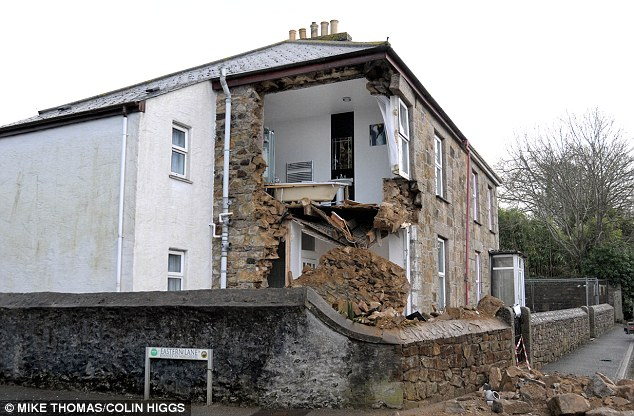 Room with a view: If nothing else, the house now stands out from its neighbours. In the nearby village of Troon engineers are working on a £1.6m project to stop homes sliding into a 300-year-old tunnel network