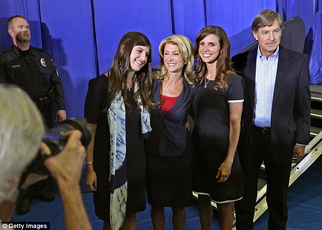 Wendy Davis stands wither her vehemently supportive daughters Dru (left) and Amber (center right) and boyfriend and former mayor of Austin, Will Wynn