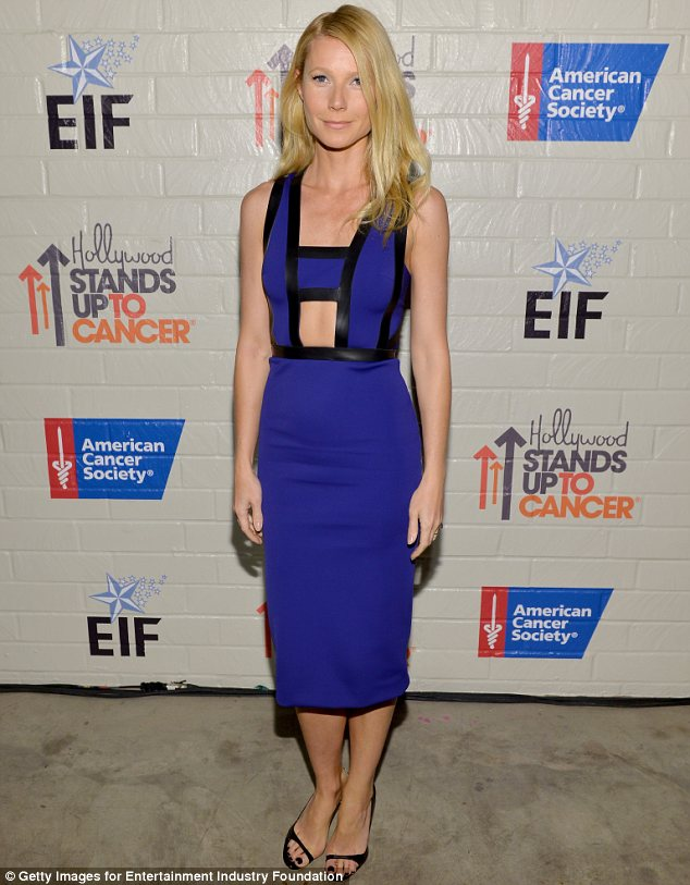 Not her best look: Gwyneth Paltrow flashed the flesh in an unusual cut-out dress at the Hollywood Stands Up To Cancer event in Culver City on Tuesday