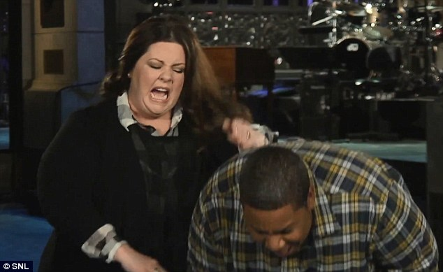 Look out! Melissa McCarthy pretended to give Kenan Thompson a swift punch to the head during a promotional video they shot for Saturday Night Live, which the star will host this weekend