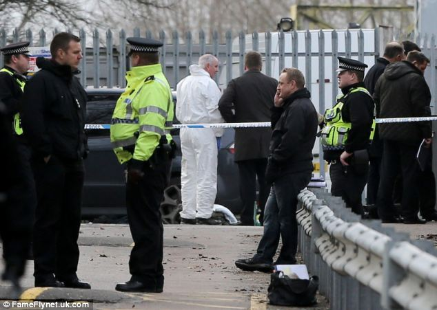 Scene: Armed officers from Essex Police scoured the scene last month at Shenfield station