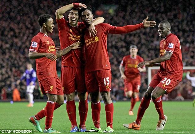 Main man: Daniel Sturridge (centre right) scored twice as Liverpool cruised to victory over Everton