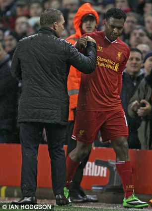 Liverpool's Daniel Sturridge argues with manager Brendan Rodgers after being substituted