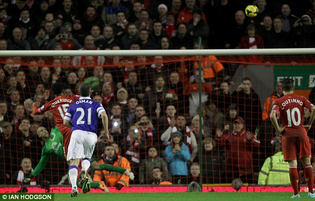Over it goes: Sturridge was gifted the chance to grab a treble but wasted the opportunity at Anfield