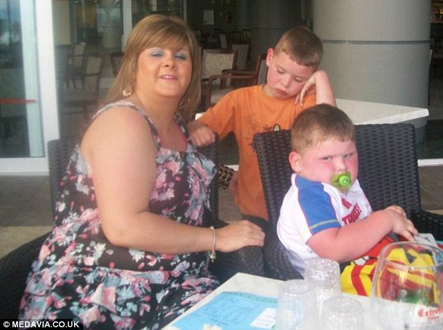 Amy said her struggle with weight began while she was pregnant with her first child Callum, now aged 9, (centre) and got worse while she was carrying her second son, Euan, now 7 (right)