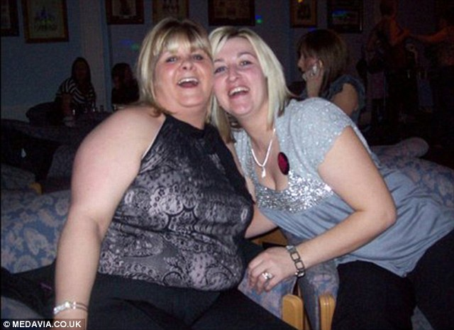 Amy pictured with a friend before she lost weight. Mother-of-three Amy Beveridge, 31, was humiliated after she was asked to step off a roller coaster because she was too large