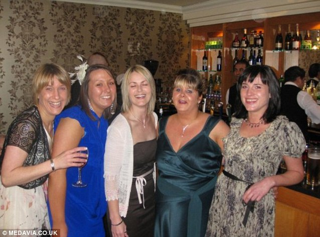 Amy, picture before she lost weight, second from right in the green dress, on a night out with friends