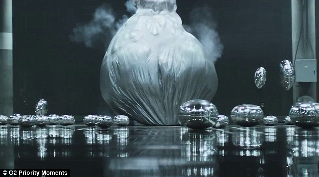 Here comes Mother Monster! The 60-second clip sees the Mother Monster hatch out of a giant silver ball to the strains of her smash hit, Applause