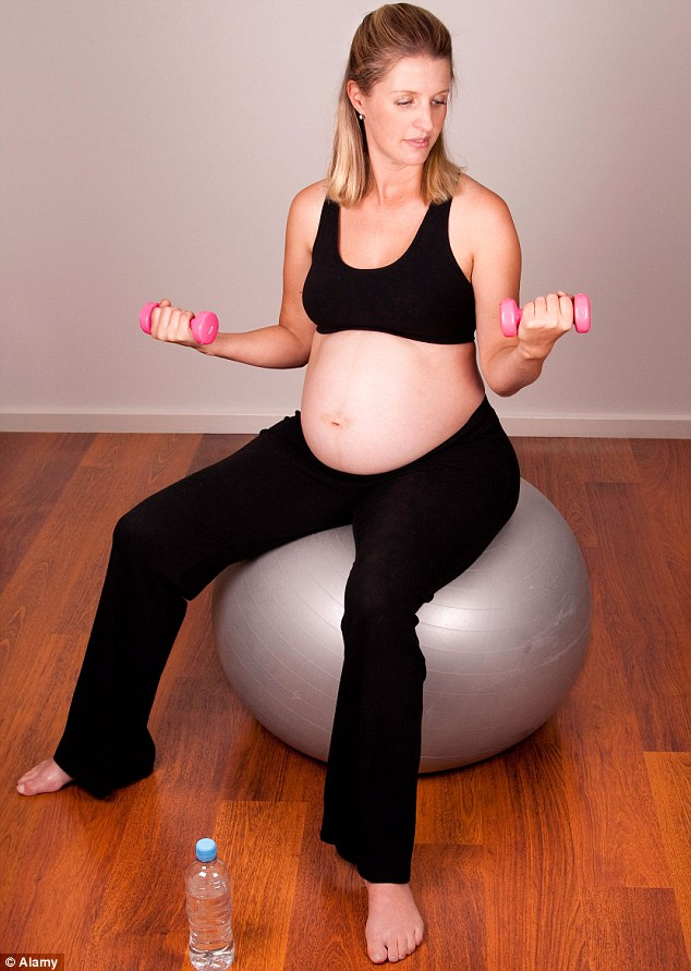 Personal cut off point: Physio Mark Buckingham said expectant mothers should listen to their body and decide when is the right time to stop exercising (posed by model)
