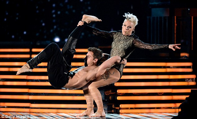She'll Try anything: The singer hoisted her partner on her knees as she belted out her hit song Try