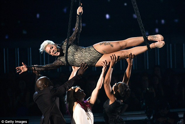 Flying high: Pink performed another one of her gravity-defying acts at Sunday's Grammy awards