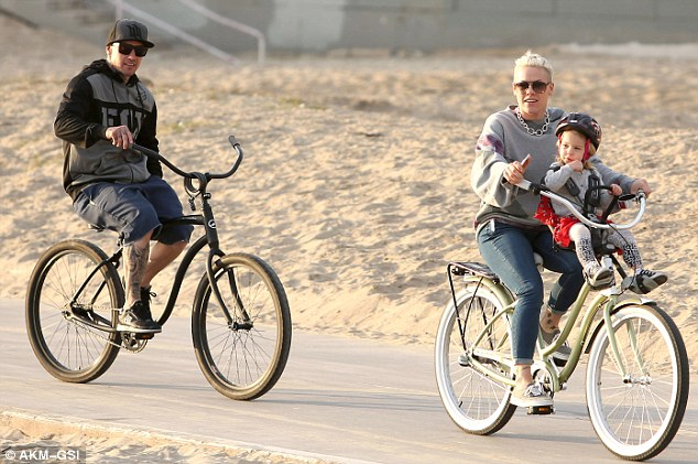 So relaxing: The singer pedaled at a leisurely pace with Willow perched in front and Carey cycling behind them