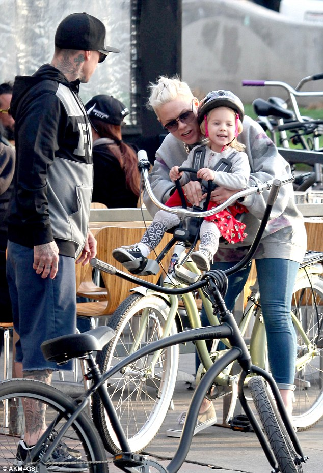 Mommy needs a rest: Pink unfastened Willow's seat buckle as the group prepared to park their bikes