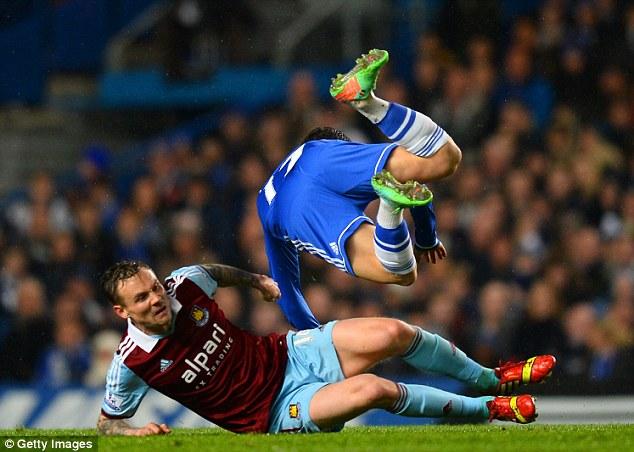 Sent flying: Matt Taylor dives in to try and dispossess Eden Hazard