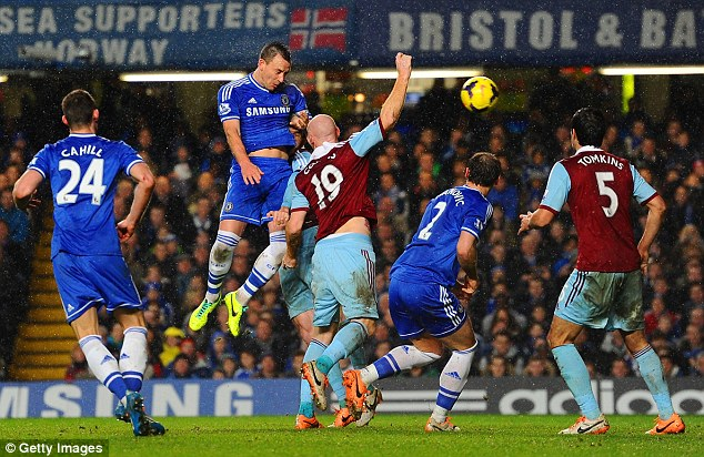 Up high: John Terry forces a good save from Adrian after a header from a corner