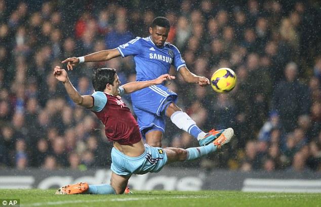 Strike: Samuel Eto'o shoots under pressure from West Ham defender James Tomkins