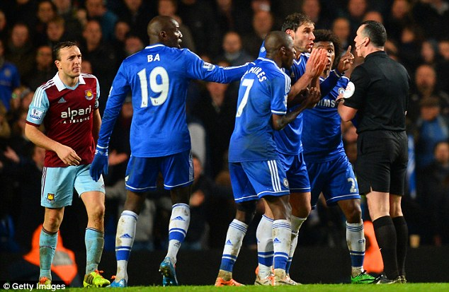 Astonished: Chelsea players plead to referee Neil Swarbrick for a decision to go their way