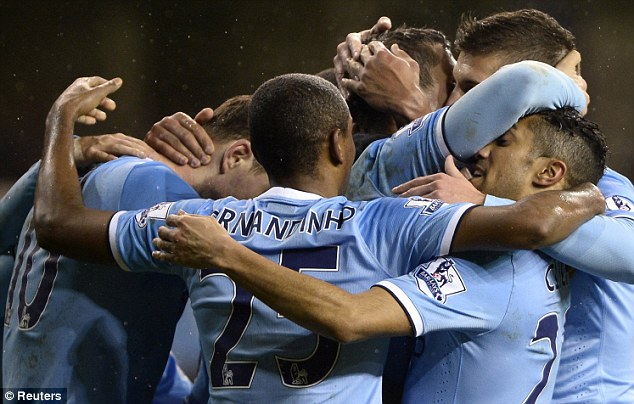 Winning team: City's players huddle together after Stevan Jovetic (obscured) scores the fourth