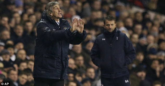 In the background: Sherwood (right) looks on as Manuel Pellegrini tells his players what to do