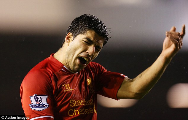Greedy: Luis Suarez shows his anger during the match as Sturridge has another attempt on goal