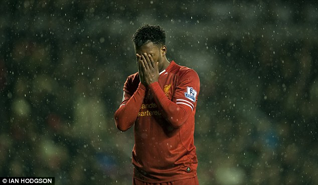 Embarrassment: Daniel Sturridge holds his head in his hands after missing a penalty against Everton
