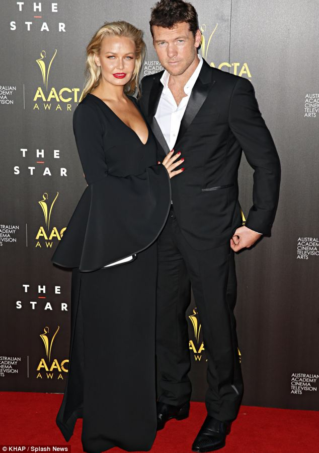 Earlier composure: Sam showed no hint that he was anything other than rock steady on his feet as he posed on the red carpet with girlfriend Lara Bingle