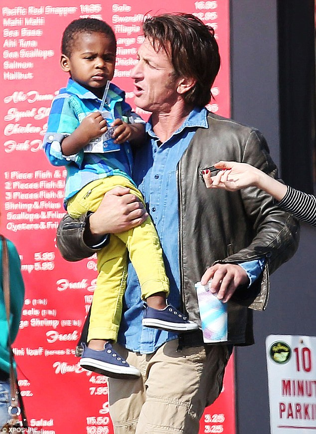 Doting: Sean carried Jackson in his arms, and the little one seemed pretty comfortable with it