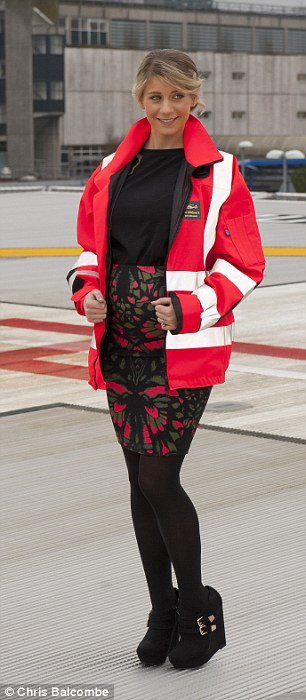 Photo shoot: The stunning lady modelled a high-vis jacket as she stood on the hospital's helipad