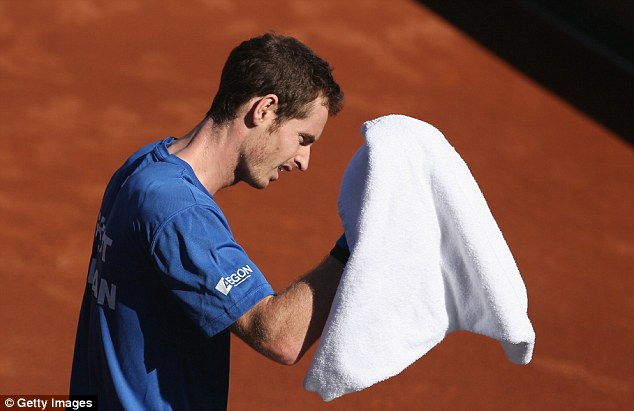 Heat is on: Murray towels off during the training session. The forecast is sunny for San Diego over the weekend, with temperature in the mid to low teens