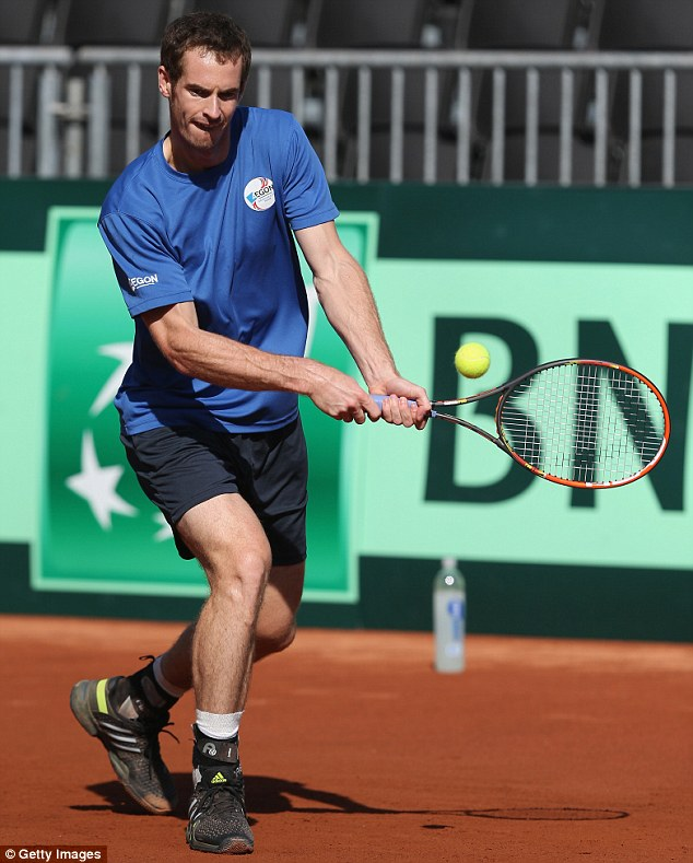 Getting in tune: Andy Murray in action during Thursday's practice session in San Diego as he prepares to play for Great Britain against the United States in the Davis Cup world group first round tie