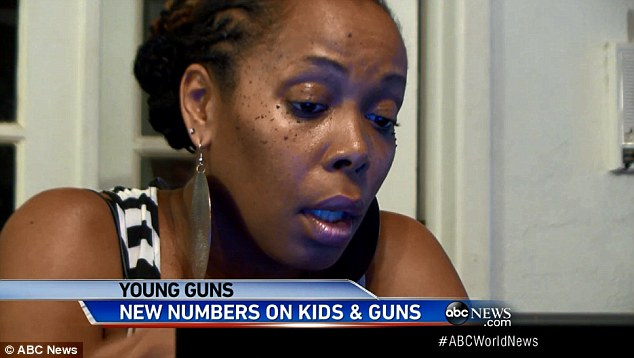 Sobering: This mother watches as her child waves around a gun inside the classroom while left unattended - she had volunteered her child because she thought they would be responsible around guns