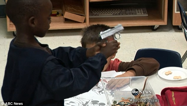 Frightening: While the guns were not loaded - they were real - and the children waited minutes and played with them before calling for help from teachers at their school