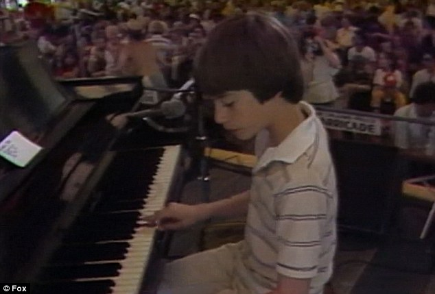 Schoolboy talent: Harry Connick Jr. was shown playing the piano as a boy